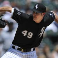 Photo - Chicago White Sox starter Chris Sale delivers a pitch during the third inning of an interleague  baseball game against the San Diego Padres in Chicago, Sunday, June 1, 2014. (AP Photo/Paul Beaty)