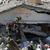 The Latest: Italian officials revise quake death toll to 241
