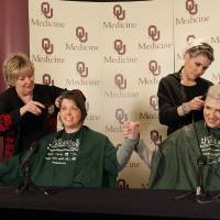 Photo - Cathy Rogers, with Heads Above Salon at the Stephenson Cancer Center, and Mary Timme, with Tonic the Salon, shave Dr. Rene McNall-Knapp and TeNeil Spaeth's heads Friday during a news conference. Photos provided by Brittany Johnson, OU Physicians