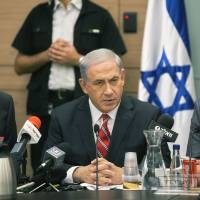 Photo - Israeli Prime Minister Benjamin Netanyahu speaks during a Foreign Affairs Committee meeting, at the Knesset, Israel's parliament in Jerusalem, Monday, June 30, 2014. At least 14 rockets launched from the Gaza Strip landed in southern Israel early Monday, the Israeli army said, the latest in an intensifying barrage from the Palestinian territory. (AP Photo/Sebastian Scheiner)