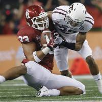 Photo - Texas A&M's Dustin Harris (22) puts a hit on Oklahoma's Trey Millard (33) as he catches the ball during the college football Cotton Bowl game between the University of Oklahoma Sooners (OU) and Texas A&M University Aggies (TXAM) at Cowboy's Stadium on Friday Jan. 4, 2013, in Arlington, Tx. Photo by Chris Landsberger, The Oklahoman