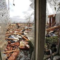 Photo - Damage to a home in the Oak Tree housing addition on Wednesday, Feb. 11, 2009, after a  tornado hit the area on Tuesday in  Edmond, Okla. PHOTO BY CHRIS LANDSBERGER