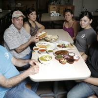 Photo - From left: Ruben Diaz, Juan M Diaz, Lorena Diaz, Veronica Flores, Fabiola Lopez, and Juan Carlos Diaz, pose for a photo at Birrieria Diaz in Bethany.  Garett Fisbeck - Garett Fisbeck