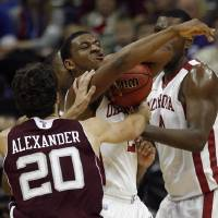Photo - Oklahoma's Steven Pledger (2) fights for a rebound with Texas A&M's Daniel Alexander (20) during the Big 12 tournament men's basketball game between the Oklahoma  Sooners and the Texas A&M Aggies at the Sprint Center, Tuesday, March, 6, 2011. Photo by Sarah Phipps, The Oklahoman