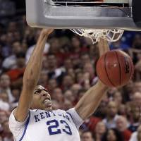 Photo -   FILE - This March 31, 2012 file photo, shows Kentucky forward Anthony Davis making a slam dunk against Louisville during the second half of an NCAA Final Four semifinal college basketball tournament game in New Orleans. Davis is a possible pick in the NBA Draft on Jan. 28.(AP Photo/David J. Phillip, File)