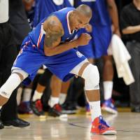 Photo -   Los Angeles Clippers forward Caron Butler reacts after scoring as time expired in the first half of an NBA basketball game against the Los Angeles Lakers, Friday, Nov. 2, 2012, in Los Angeles.(AP Photo/Gus Ruelas)