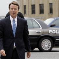 Photo -   Former presidential candidate and Sen. John Edwards arrives at a federal courthouse in Greensboro, N.C., Tuesday, May 8, 2012. Edwards is accused of conspiring to secretly obtain more than $900,000 from two wealthy supporters to hide his extramarital affair with Rielle Hunter and her pregnancy. He has pleaded not guilty to six charges related to violations of campaign-finance laws. (AP Photo/Chuck Burton)