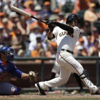 Photo - San Francisco Giants' Gregor Blanco swings for a two run double off New York Mets' Zack Wheeler in the second inning of a baseball game Sunday, June 8, 2014, in San Francisco. (AP Photo/Ben Margot)