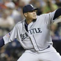 Photo - American League's Felix Hernandez, of the Seattle Mariners, pitches during the fourth inning of the MLB All-Star baseball game, on Tuesday, July 16, 2013, in New York. (AP Photo/Kathy Willens)