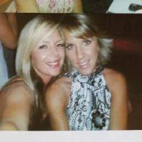 Photo - This is one of about six photos of Barbara Diane Day (on the right) pictured with unidentified friends, taped to the front door of the couple's fitness center in  Elgin. Residents of  Elgin Okla, react Tuesday, July 20, 2010, to yesterday's shooting death of local teacher Barbara Diane Dye at the hand of her husband, Raymond Lee Dye, 42, in the parking lot of a bank in this southwest Oklahoma community of about 1400 people just north of Lawton. Photo by Jim Beckel