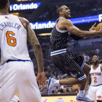 Photo - Orlando Magic's Arron Afflalo, center, drives to the basket while defended by New York Knicks' Tyson Chandler (6) and Raymond Felton (2) during the first half of an NBA basketball game in Orlando, Fla., Friday, Feb. 21, 2014. (AP Photo/Willie J. Allen Jr.)