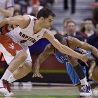 Photo - Toronto Raptors' Jose Calderon, left, challenges Oklahoma City Thunder's Russell Westbrook, right, during third-quarter NBA basketball game action in Toronto, on Friday, March 27, 2009. (AP Photo/The Canadian Press,Chris Young) ORG XMIT: CFWY120