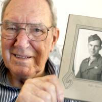 Photo - In his Del City home Thursday, Francis Bickell shows a photo of himself from World War II.  Photo By Sarah Phipps,  The Oklahoman