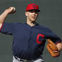 Photo - Cleveland Indians starting pitcher Justin Masterson throws during spring training baseball practice in Goodyear, Ariz., Thursday, Feb. 13, 2014. (AP Photo/Paul Sancya)