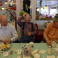 Photo -   On this election day, as they do every day, people gather for breakfast in the Nutcracker Restaurant, a 1950's-style diner, in Pataskala, Ohio on Tuesday, Nov. 6, 2012. From left are Ken Armentrout, Lewie Hoskinson and Jack Cruikshank. Hoskinson, center, is a retired city worker who his friends claim is the only President Barack Obama supporter in the town of 14,000.