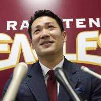 Photo - FILE - In this Dec. 17, 2013 file photo, Rakuten Golden Eagles pitcher Masahiro Tanaka speaks at a press conference after a meeting with his club president, in Sendai, northern Japan. Tanaka's team says it has decided to let him seek his career in Major League baseball next season, reversing its earlier rejection. Rakuten Eagles president Yozo Tachibana told a news conference Wednesday, Dec. 25, 2013 that it has decided to release him through the posting system. (AP Photo/Kyodo News, File) JAPAN OUT, MANDATORY CREDIT