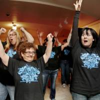 """Photo -  Jackie Ward, left, and Kelly Brown dance to Katy Perry's hit song """"Roar"""" during a flash mob at the state Capitol on Thursday. Ward is from the 10th Street Group Home in Duncan. Brown worked with the residents on the dance choreography. Photos by Jim Beckel, The Oklahoman   Jim Beckel -"""