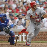 Photo - St. Louis Cardinals' Matt Adams watches his two-run triple against the Chicago Cubs during the seventh inning of a baseball game on Saturday, July 26, 2014, in Chicago. (AP Photo/Andrew A. Nelles)