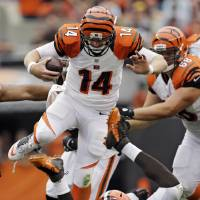 Photo - Cincinnati Bengals quarterback Andy Dalton (14) is tripped up by Cleveland Browns linebacker Barkevious Mingo on a short run in the third quarter of an NFL football game Sunday, Sept. 29, 2013, in Cleveland. (AP Photo/Mark Duncan)