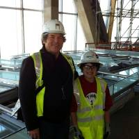 Photo - Xander Moore, right, with his grandfather Rick Brown, left, are shown in the top floor of Devon Energy Center during their recent visit. Moore is battling cancer and was given a tour of the 50-story building by Devon executives and contractors.  provided