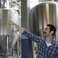 Photo - Bryant Goulding, co-founder and co-owner of Rhinegeist, talks about the brewery Wednesday, June 19, 2013, in Cincinnati. They are set to open a tap room to the public on June 29 in what used to be part of the old Christian Moerlein complex. (AP Photo/Al Behrman)