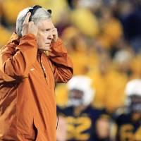 Photo -  Texas coach Mack Brown will reportedly step down in Austin. That's news to him. (AP Photo/Christopher Jackson)