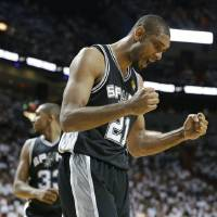 Photo - San Antonio Spurs forward Tim Duncan (21) reacts to play against the Miami Heat during the second half of Game 6 in their NBA Finals basketball series, Tuesday, June 18, 2013 in Miami. (AP Photo/Lynne Sladky)