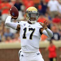 Photo - UCLA quarterback Brett Hundley (17) throws a pass during the first half of an NCAA college football game against Virginia at Scott Stadium, Saturday, Aug. 30, 2014, in Charlottesville, Va. (AP Photo/Andrew Shurtleff)