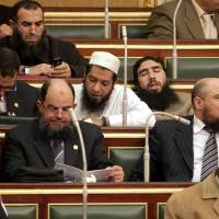 Photo -   FILE - In this Monday, Jan. 23, 2012 file photo, Salafi lawmakers attend the first Egyptian parliament session after the revolution that ousted former President Hosni Mubarak, in Cairo, Egypt. Internal divisions are threatening to unravel Egypt's second biggest political party, the political arm of the ultraconservative Salafis, the country's most hardline Islamist movement.(AP Photo/Asmaa Waguih,Pool, File)