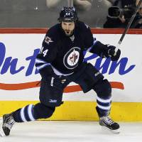 Photo - Winnipeg Jets' Zach Bogosian (44) celebrates his goal against the Carolina Hurricanes during the first period of their NHL hockey game in Winnipeg, Manitoba, Thursday, April 18, 2013. (AP Photo/The Canadian Press, John Woods)