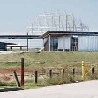 Photo - The Eastern Avenue entrance to the American Indian Cultural Center and Museum in Oklahoma City is shown in October. Work halted in July because funding ran out. Photo by Paul B. Southerland, The Oklahoman