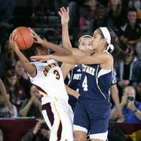 Photo - Notre Dame's Skylar Diggins (4) pressures Central Michigan's Jessica Green (3) during the second half of an NCAA college basketball game on Thursday, Nov. 29, 2012, in Mount Pleasant, Mich. Notre Dame won 72-63. (AP Photo/Al Goldis)