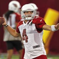 Photo -   Arizona Cardinals quarterback Kevin Kolb (4) throws during NFL football practice on Thursday, Sept. 13, 2012, at Arizona State University in Tempe, Ariz. The Cardinals are to face the New England Patriots on Sunday. (AP Photo/Matt York)