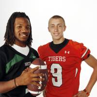 Photo - HIGH SCHOOL FOOTBALL ZONE PREVIEW: From left, Bryan Payne of Norman North and George Kittle of Norman pose for a photo at the OPUBCO studio in Oklahoma City, Saturday, Aug. 20, 2011. Photo by Nate Billings, The Oklahoman ORG XMIT: KOD