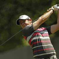 Photo -   Rory McIlroy, of Northern Ireland, watches his tee shot on the fourth hole during the pro-am of the Wells Fargo Championship golf tournament at Quail Hollow Club in Charlotte, N.C., Wednesday, May 2, 2012. (AP Photo/Chuck Burton)