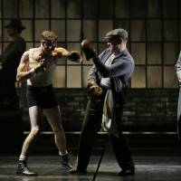 Photo - This theater image released by Lincoln Center Theater shows, from left, Seth Numrich, Danny Burstein and Danny Mastrogiorgio in
