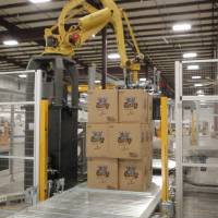 Photo - A robot handles cases of products at Orchids Paper Products in Pryor.   - PROVIDED BY ORCHIDS PAPER PRODUC