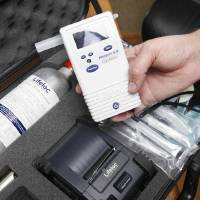 Photo - Susan Lobsinger, president of  USA Mobile Drug Testing of Oklahoma, holds a breathalyzer to test for alcohol use ather office  in Oklahoma in Oklahoma City. Photo by Paul B. Southerland, The Oklahoman  PAUL B. SOUTHERLAND - PAUL B. SOUTHERLAND