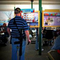 Photo -  Gun rights advocates brought firearms to a Texas Sonic Drive In at a recent demonstration.  Photo provided by Moms Demand Action for Gun Sense in America     -  Moms Demand Action for Gun Sense in America