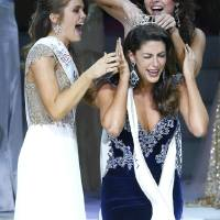 Photo - Miss Oklahoma 2014 Alexandra Eppler, foreground, from Enid, is crowned by Miss Oklahoma Outstanding Teen Joei Whisenant, left, and Miss Oklahoma 2013 Kelsey Griswold.  PhotoS by James Gibbard, Tulsa World   JAMES GIBBARD
