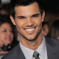 Photo - Taylor Lautner attends the world premiere of