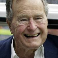 Photo - FILE - In this Nov. 4, 2012 file photo, former president George H.W. Bush pauses for a photo before an NFL football game in Houston between the Buffalo Bills and the Houston Texans. Former President George H.W. Bush is celebrating his 90th birthday in Maine. Thursday June 12, 2014. A family spokesman says a private dinner Thursday evening features a guest list of more than 200 friends and relatives. (AP Photo/Eric Gay, File)
