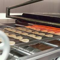 Photo - Sausage patties cook at Lopez Foods in Oklahoma City.   - PROVIDED