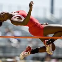 Photo - Del City High School's Toni Young competes in the Class 6A high jump during the state track and field meet in Ardmore, Okla., Friday, May 9, 2008. Young won the class 6A championship. BY BRYAN TERRY, THE OKLAHOMAN ORG