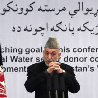 "Photo - Afghan President Hamid Karzai gestures, as he speaks during a conference about water management in Kabul, Afghanistan, Tuesday, Jan. 29, 2013. Hamid Karzai. Karzai spoke Tuesday at a conference about water management, where he first talked about the need for clean water systems and then broke off to address what he described as a ""very important issue"" -- the varied attempts at peace talks with the Taliban -- warning against peace talks with the Taliban without the Afghan government's involvement. (AP Photo/Ahmad Jamshid)"