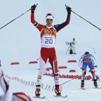 Photo - Norway's Magnus Krog crosses the finish line to win the bronze during the cross-country portion of the Nordic combined at the 2014 Winter Olympics, Wednesday, Feb. 12, 2014, in Krasnaya Polyana, Russia. (AP Photo/Matthias Schrader)