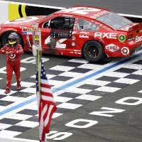 Photo - Juan Pablo Montoya, of Colombia, leaves his car after it ran out of gas on the finish line at the end of the NASCAR Sprint Cup series auto race on Sunday, June 23, 2013, in Sonoma, Calif. (AP Photo/Ben Margot)
