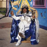 Photo -   In this 2001 image released by The Historic New Orleans Collection, Ernie K-Doe poses outside of his Mother-In-Law Lounge during Jazz Fest in New Orleans. A new book published by the Historic New Orleans Collection,