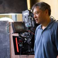 Photo -   This film image released by 20th Century Fox shows director Ang Lee on the set of