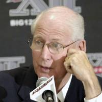 Photo - Kansas State coach Bill Snyder laughs as he answers reporters questions during a news conference at the Big 12 Football Media Day Tuesday, July 27, 2010 in Irving, Texas. (AP Photo/Cody Duty) ORG XMIT: TXCD106